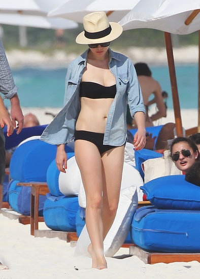 Over 50 Celebrity Beach Looks to Inspire Your Spring Break Style: In Mexico in January, Michelle Williams covered up her black bikini with a chambray button-down, then added a cool panama hat.