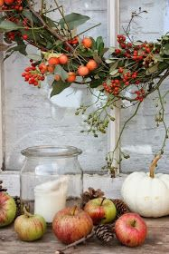 Twiggy wreath with fall berries, hips, and white pumpkins and apples