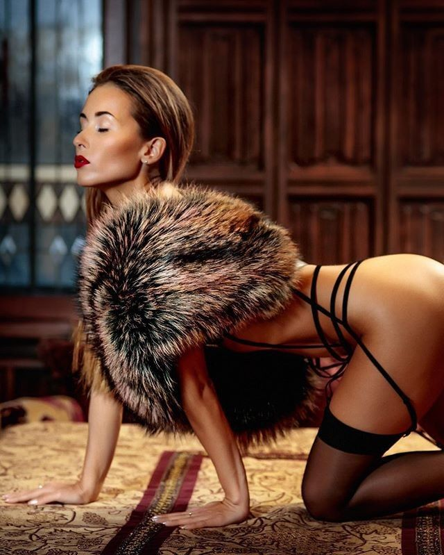 Beautiful sexy woman wearing fur coat stock photo