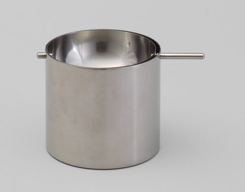 Cylinda Ashtray Arne Jacobsen (Danish, 1902–1971)  1964-67. Stainless steel, Overall: 2 5/8 x 3 x 4 3/8 (6.7 x 7.6 x 11.1 cm) .a (cylindrical cup): h. 2 5/8 (6.7 cm), diam. 3 (7.6 cm) .b (inset rotating hemispherical bowl): 1 1/2 x 2 3/4 x 4 3/8 (3.8 x 7 x 11.1 cm). Manufactured by Stelton A/S, Copenhagen, Denmark.