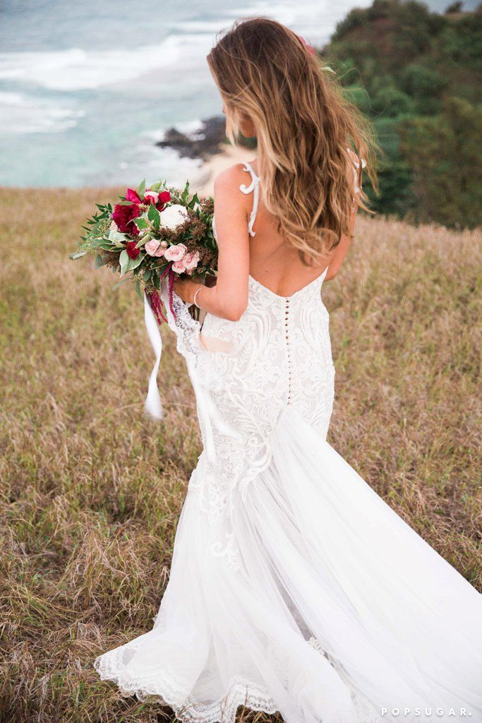 Audrina Patridge and Corey Bohan's Romantic Hawaiian Wedding | Recreate her beach wedding style in a Galina Soft Lace Sheath Wedding Dress with Low Back (WG3827) available at David's Bridal