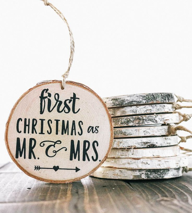 """The holidays are always special but can be even more so if it's your first as newlyweds. This rustic wood ornament adds to the celebration featuring """"First Christmas as Mr. & Mrs."""" hand-painted on a slice of birch wood and 2015 on the back. It hangs from a length of twine, to add to the Christmas tree year after year."""