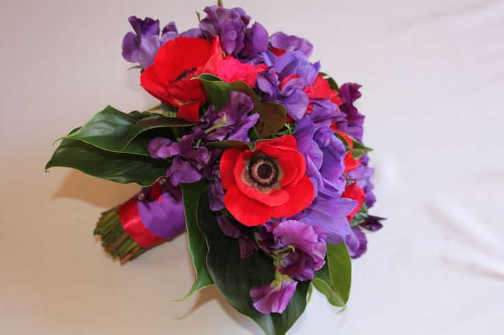 Red and Purple bridal bouquet with Red Anemone, Purple Sweet Pea, Purple Anemone and red rose. Created by Poppies and Peas Floral Design.