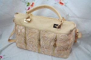 Loretta Lace Day Bag, available in cream and black.