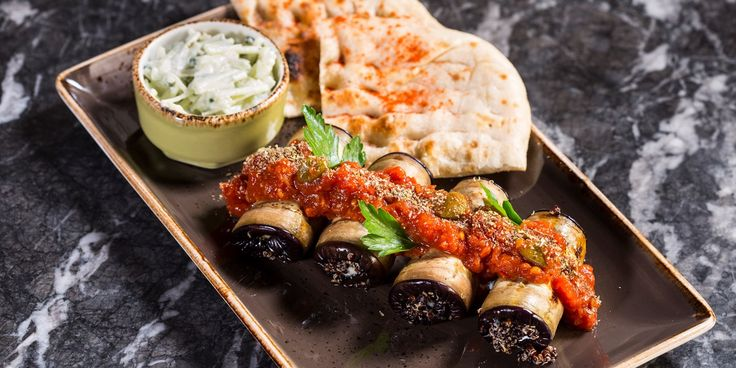This vegetarian moussaka recipe from chef Alfred Prasad uses black quinoa to create a hearty filling for these moussaka rolls served with a fresh tzatziki dip.