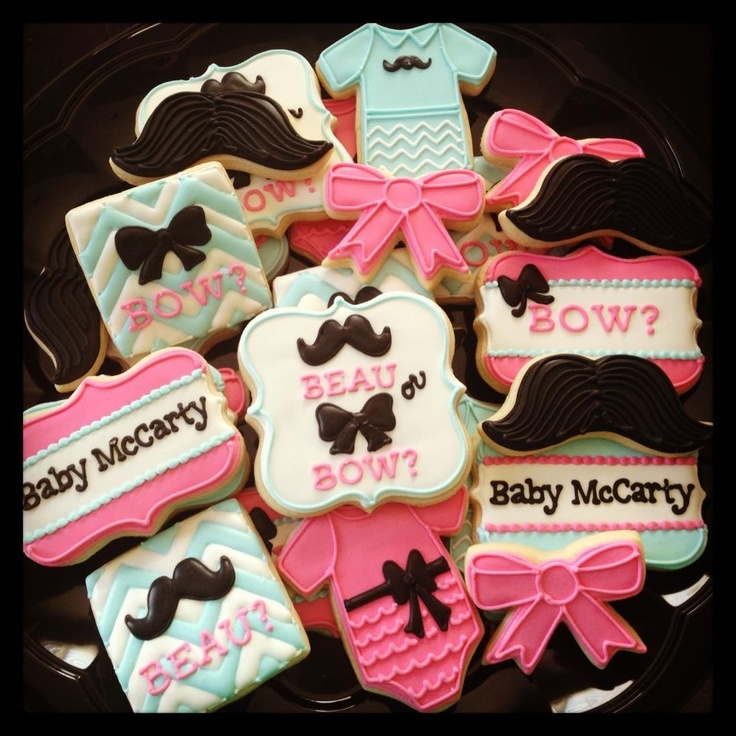 Colourful and cute gender reveal cookies.