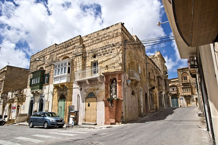 Historic architecture on Gozo features decorative wooden balconies, a feature from the days of the Arab occupation of the Maltese Islands