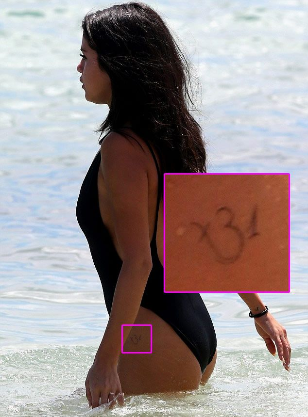 Selena Gomez Reveals New Spiritual Om Hip Tattoo During Miami Beach Vacay - http://www.popstartats.com/selena-gomez-tattoos/hip-om/