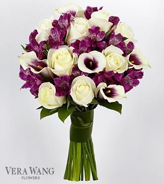 white roses, purple Peruvian Lilies and bi-colored white and purple mini calla lilies are accented by lush greens