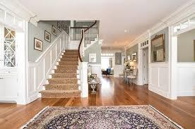 Medium toned floors with sage walls