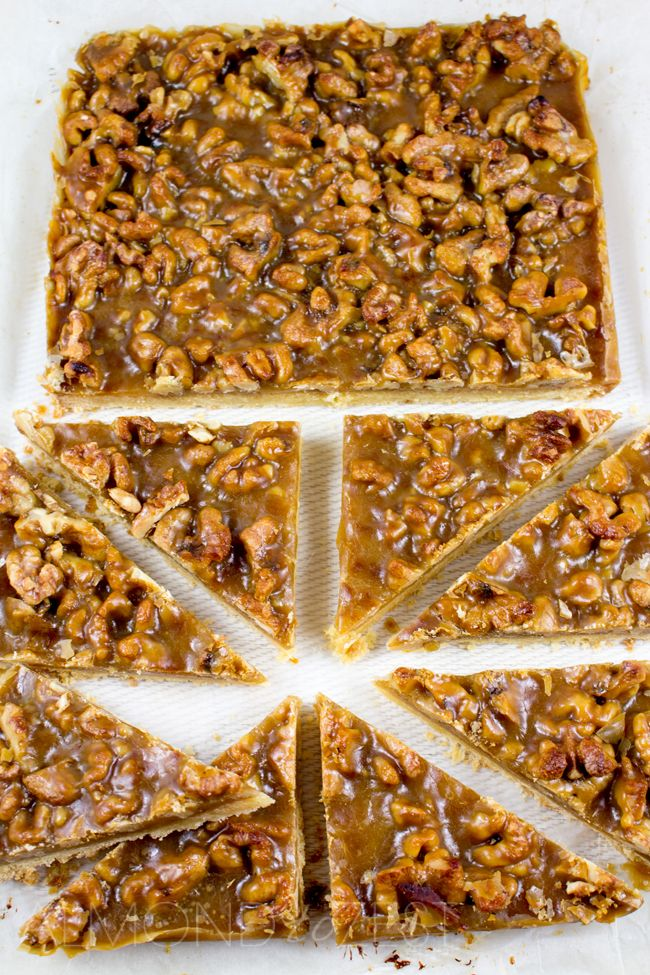 Caramel and Walnut Slice - Super soft, crumbly slice topped with crunchy walnuts and chewy caramel! You HAVE to try this it's crazy good!! @almondtozest