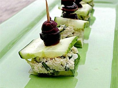 Chicken Salad Cucumber Bites...refreshing! 7_INGREDIENTS - 7 ingredients: 1 whole English Cucumber, Sliced, Skin On 7 ounces, weight Cooked Chicken Breast, Shredded 2 Tablespoons Mayonnaise, Light 2 Tablespoons Fresh Cilantro, Chopped 2 whole Scallions, Chopped ¼ teaspoons Cumin Salt And Pepper, to taste 24 whole Olives (Kalamata, Black, Or Green), For Garnish (optional)