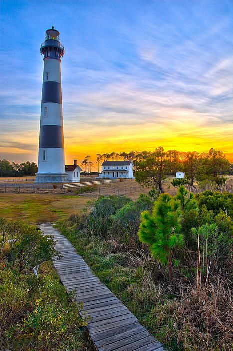 New Fine art seascape for sale. Vivid sunset at Bodie Lighthouse on the Outer Banks of North Carolina; available in fine art and painted styles. #artforsale #seascape #photograph.
