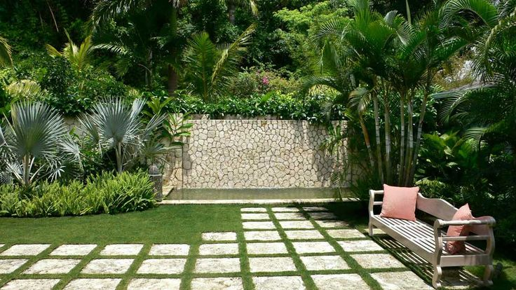 Small Garden in The Backyard Design Ideas with rocks backyard ideas green trees and garden design plans white fitted one long two wooden chair cushions pink grass