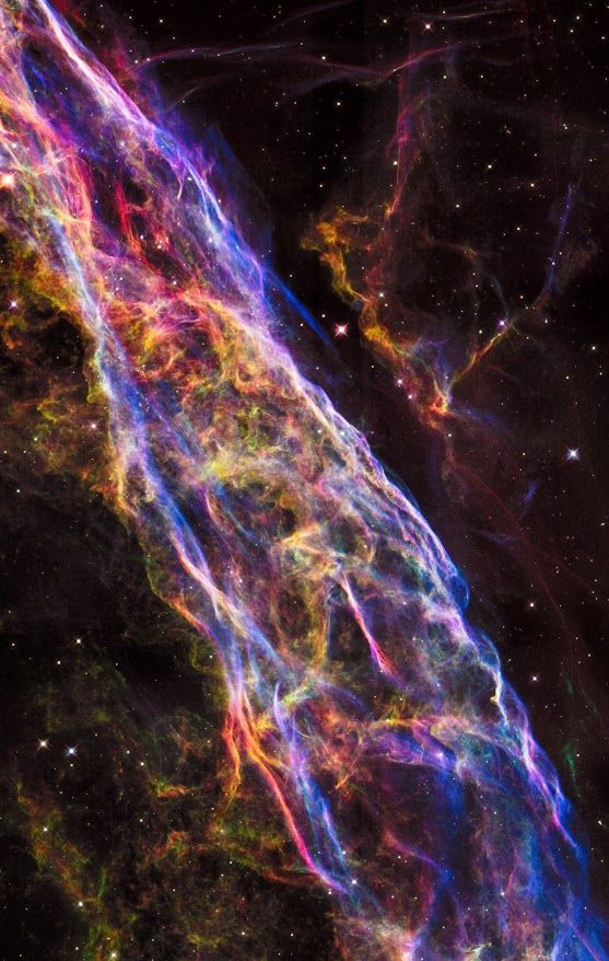 NASA's Hubble Space Telescope has unveiled in stunning detail a small section of the expanding remains of a massive star that exploded about 8,000 years ago. Called the Veil Nebula, the debris is one of the best-known supernova remnants, deriving its name from its delicate, draped filamentary structures. The entire nebula is 110 light-years across, covering six full moons on the sky as seen from Earth, and resides about 2,100 light-years away in the constellation Cygnus, the Swan.