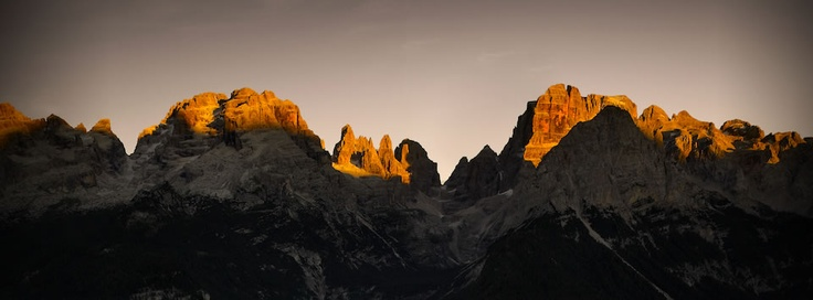 """The Dolomites, one of the symbols of Trentino, are unique mountains because the sun's rays give the rocks a fiery red glow at dawn and sunset, a phenomenum called """"enrosadira"""". Peaks like the Torri del Vajolet or Campanil Basso di Brenta are known everywhere, and not only by mountaineers  The French maestro Le Corbusier defined these mountains """"the most beautiful work of architecture in the world""""."""