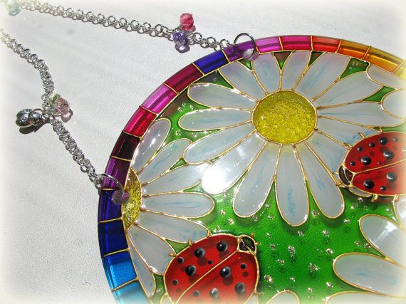 Suncatcher Ladybugs on Daisies Hand Painted Glass Painting Home Decor Window Hanging Gift My favourite season summer inspires me to create such light and clorful painting. This hand painted Suncatcher includes true summer attributes - ladybugs, daisies and rainbow :) My Suncatchers have a lovely glow when the sun lights them up, and they also make you happy on a cloudy day. Very fun, bright and positive glass panel. A wide variety of colors are present in the panel of green, blue, orange…