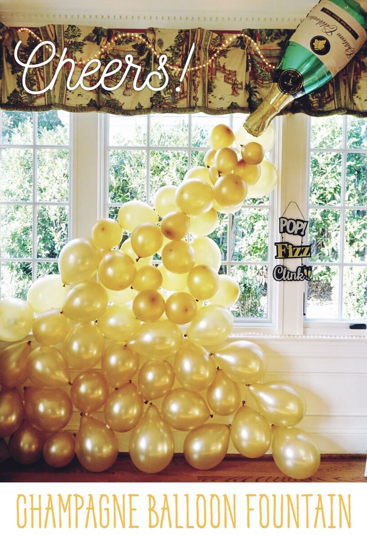 Our Champagne Balloon Fountain was a hit at our New Year's Eve Party and would be perfect for lots of celebrations -- birthday, anniversary, bridal or bachelorette, graduation and more! Champagne bottle balloon from Party City (ours was filled with air, not helium) and then a bag of gold balloons. We used about 40-50 balloons (certain areas have a double layer of balloons) and masking tape / double sided tape to secure them to the wall, window and each other. Cheers!