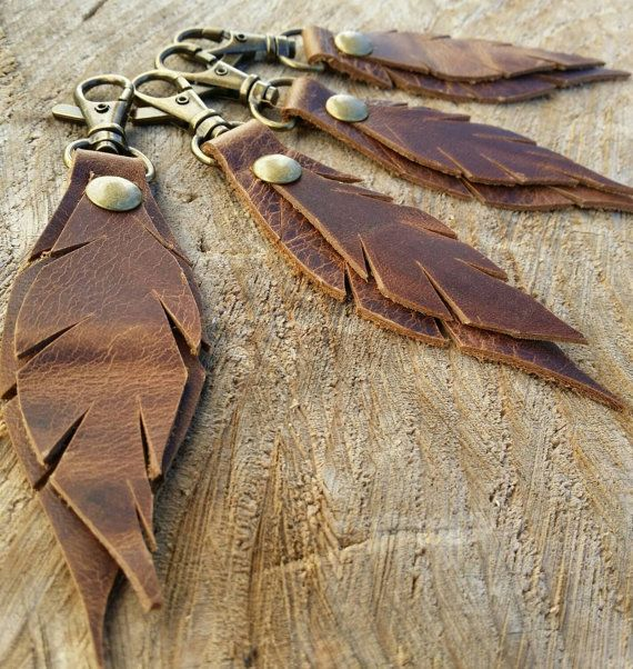 Check out this item in my Etsy shop https://www.etsy.com/listing/250802374/feather-keychain-leather-key-chain