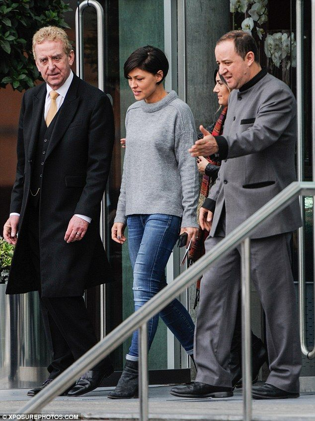 Casual look: Emma was dressed down in a grey knit and skinny jeans teamed with black ankle boots