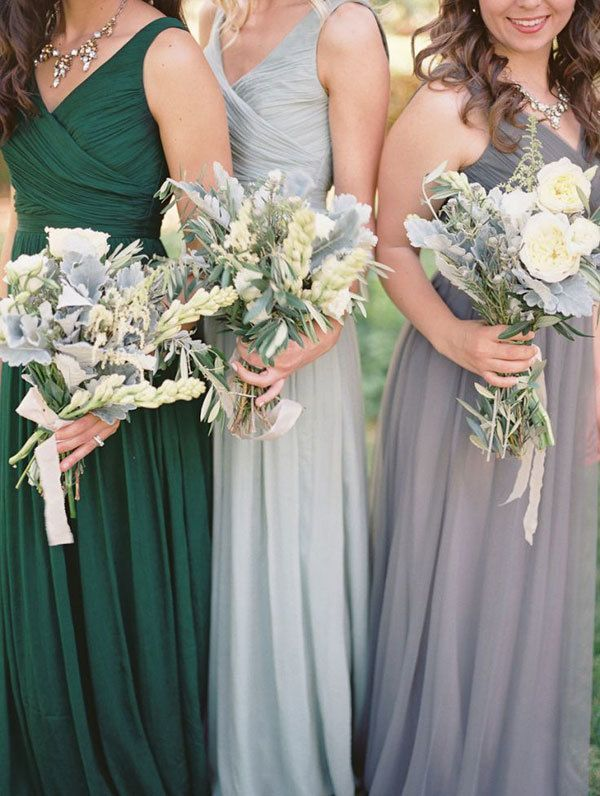 bridal party in bridesmaid dresses in emerald, pewter, and silver, holding white bouquets with dusty miller Women, Men and Kids Outfit Ideas on our website at 7ootd.com #ootd #7ootd