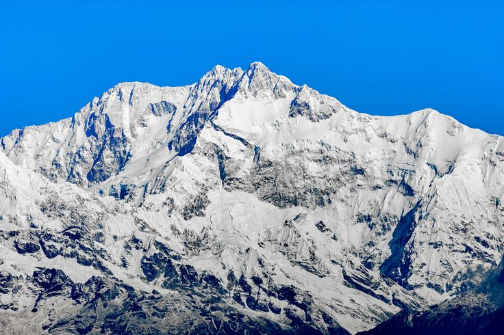 Snaowcapped Kanchenjunga third highest peak of the world - Snaowcapped mountain peaks of Himalayas, Kanchenjunga with copy space