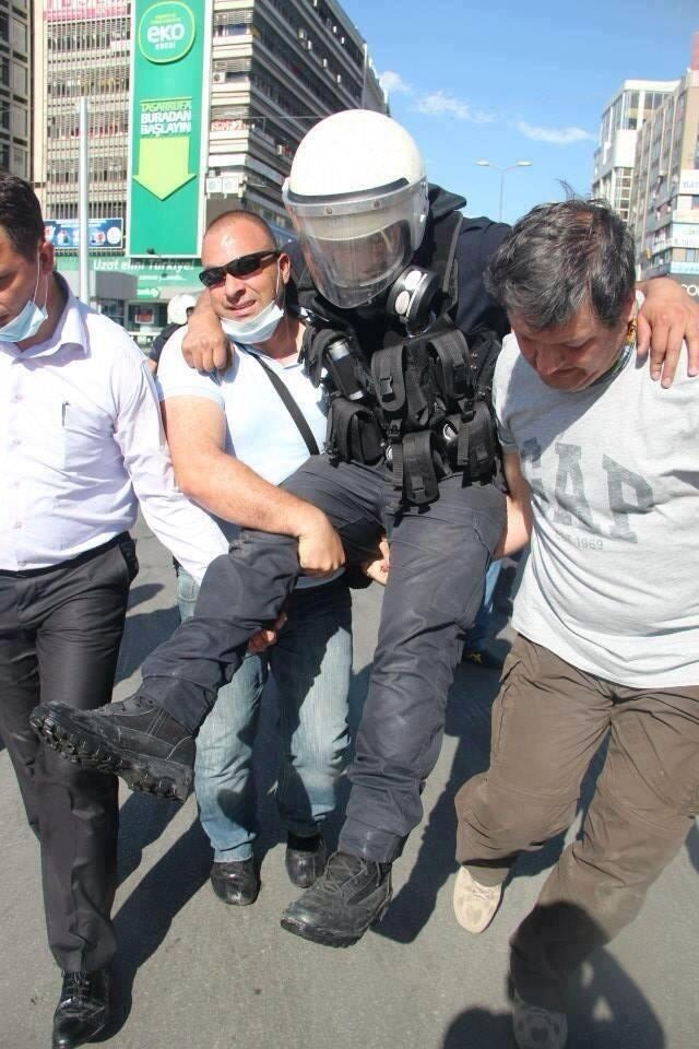 Protesters in Turkey helping an injured police officer. #direngeziparki #currentevents