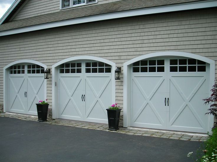 @C.H.I. Overhead Doors model 5534 Fiberglass Carriage House Style Garage Doors with Overlay, Stockton Glass & Flat Black Spade Decorative Hinges