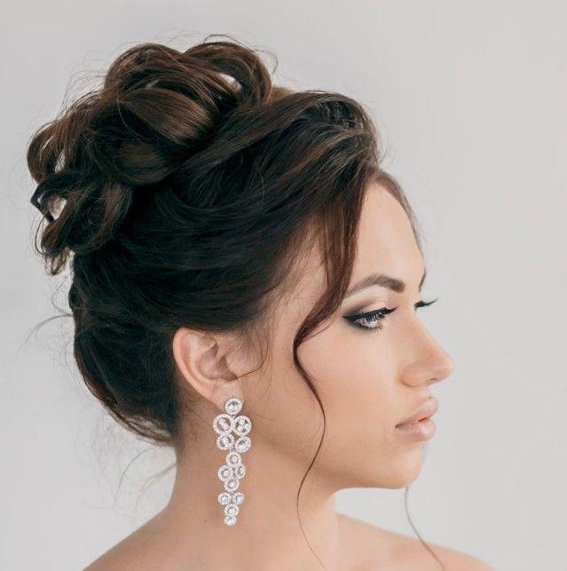 coiffure mariage cheveux long - chignon flou et frange ondulée