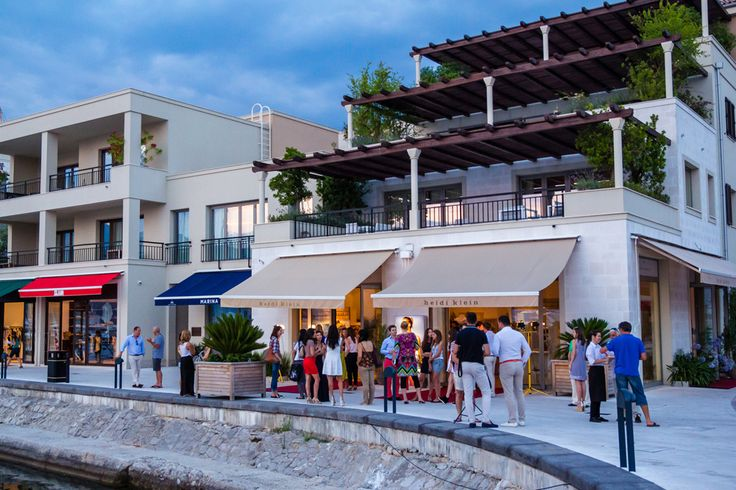 Porto Montenegro the new hotspot for the European smart set. Porto Montenegro, once the main base for the Austro-Hungarian navy, is now home to super-yachts, gin palaces, infinity pools, nightclubs, fleets of helicopters - and festering controversy.