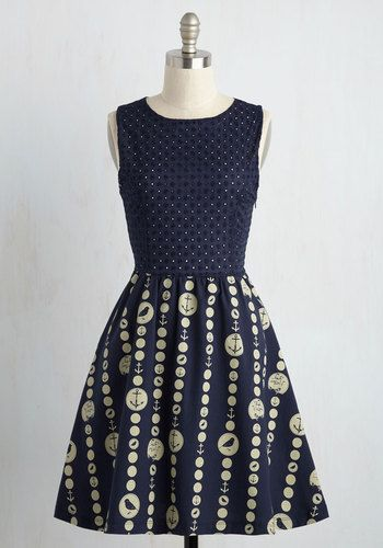 As someone who lives in the moment, you choose this nautical dress to make every instant magnificent. This navy blue frock navigates through a sea of style with a perforated bodice, a pleated skirt, and an ivory print of dots filled with ships, anchors, and birds. A voyage in this dress makes for vogue bliss!