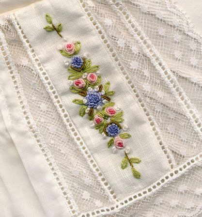 Embroidered insert on collar features bullion roses and French knots. Paired with periwinkle blue button-on pants (not shown). Made by Trudy Horne