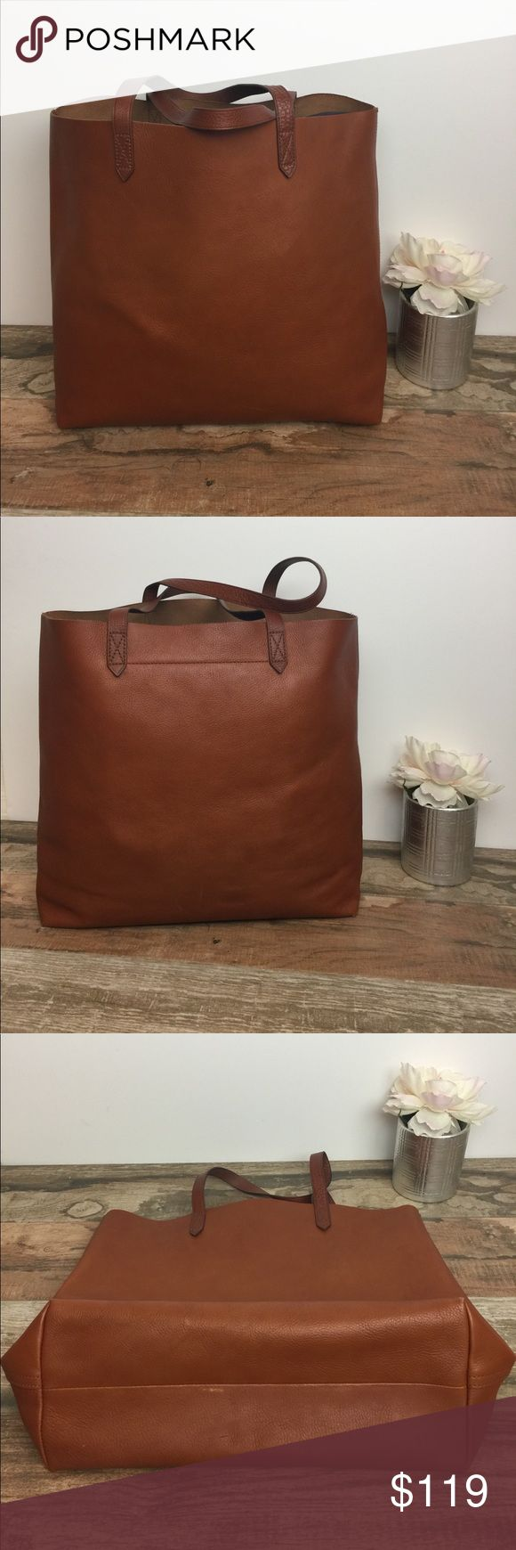 Madewell Transport Tote Madewells Best Seller! In good condition. Faded corners. Marks on bottom back of bag and lower back of bag. Structure of bag is excellent. Color is English saddle. Madewell Bags Totes