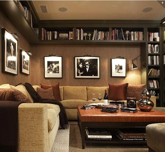 Love the bookcase-rimmed ceiling