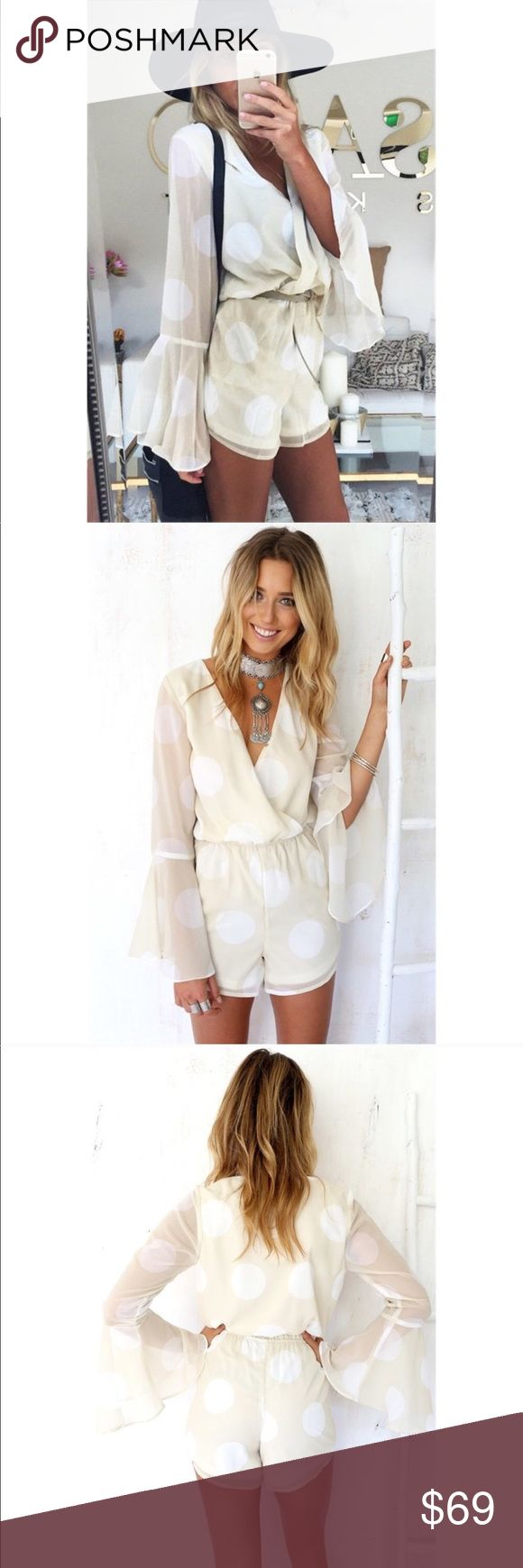 SABO SKIRT Deep V Bell Sleeve Playsuit Romper XS Stunning SABO SKIRT Polka Dot long sleeve playsuit Romper. Size XS. Retail price $80. Mint condition with no flaws. No trades please 🖤 100% Polyester.  This gorgeous cream beige playsuit features white polka dots and a low V plung neckline. Elastic waist. Back invisible zip closure. Long bell sleeves. Lined. Sabo Skirt Pants Jumpsuits & Rompers