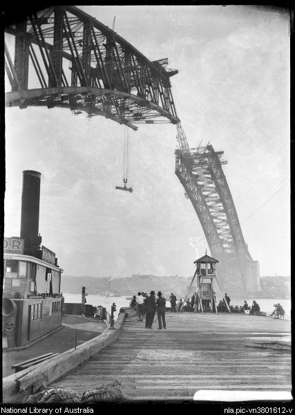 Arch over Dawes Point, Sydney Harbour Bridge, arch incomplete, girder being lifted [picture] 1930. From the National Library of Australia