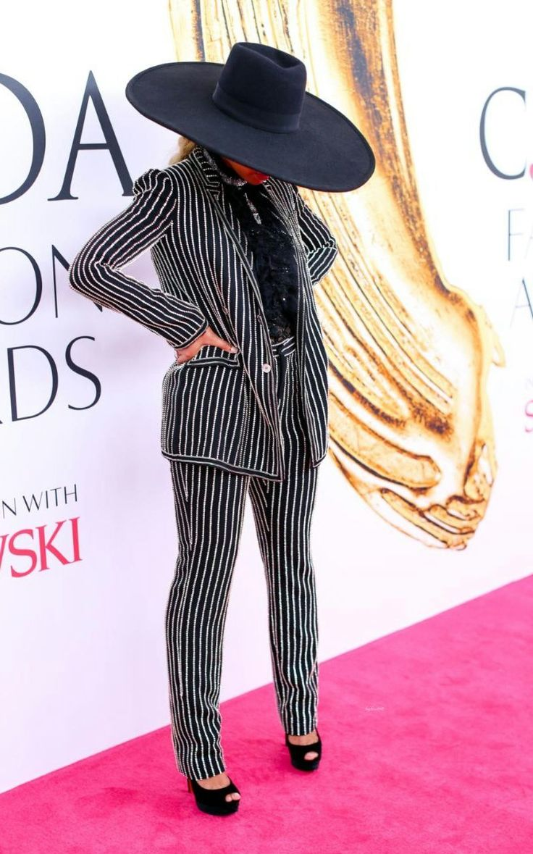 black wide brim hat + black and silver stripe suit + black ruffle blouse + black heels