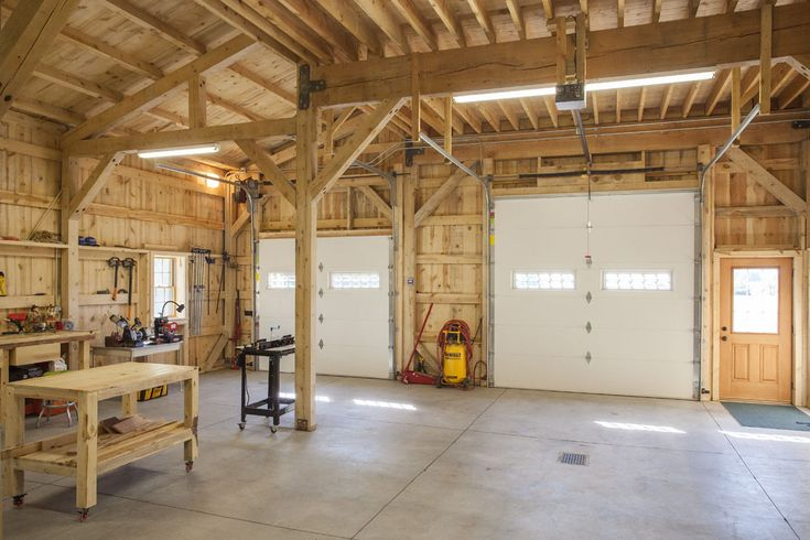 Wood post beam barn used as a garge workshop sand