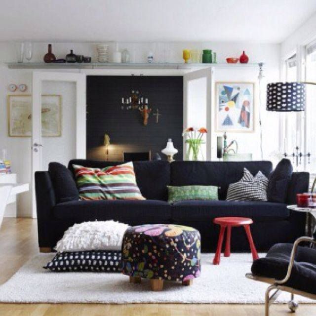 Black sofa. Velvet makes it reflective makes it appear lighter
