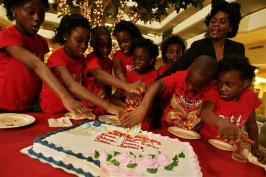 The surviving Chukwu octuplets celebrate their 10th birthday Saturday. From left, Ebuka, Echerem, Jioke, Chima, Gorom, Chidi and Ikem, cut the cake with their mom, Nkem Chukwu, right, and their youngest sister, Favor, 6. Photo: Eric Kayne, Houston Chronicle