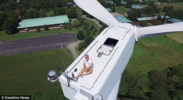 The remarkable video shows the moment the drone reached the top of the turbine and found t...