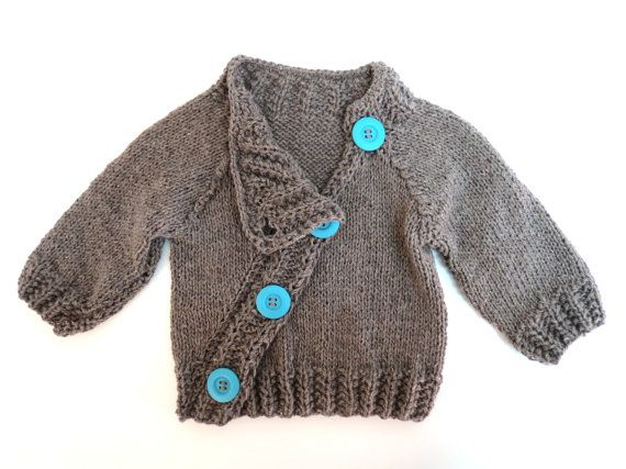 Adorable baby sweater with an asymetric look, 4 big stylish buttons. Made of super soft 100% wool yarn.  Hand knitted and designed by me, with great