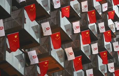 Chinese national flags and flags with the Beijing Olympic logo are hung at a building in Wuhan, Hubei province