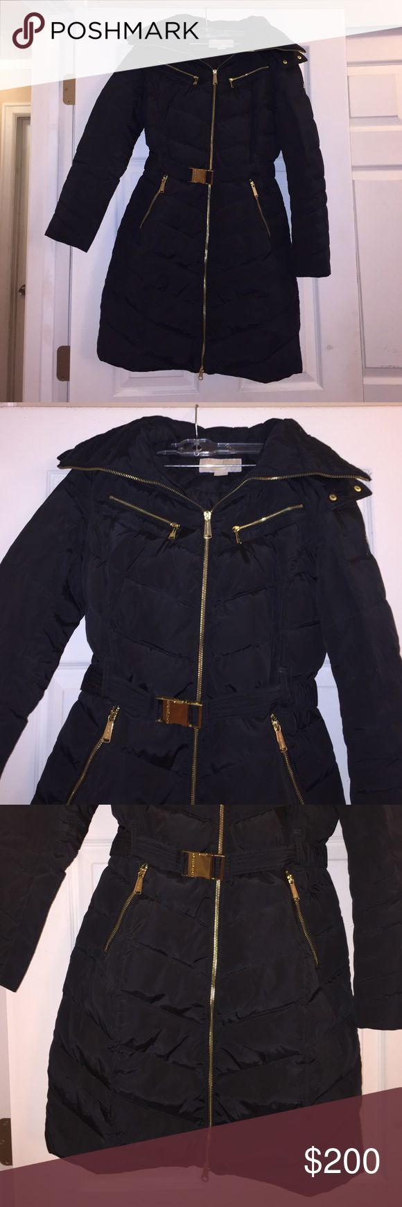 Micheal Michael Kors Black Long Puffer Coat XS New. Black long Puffer coat. Lined. Pockets. Belt. Removable hood. Faux Fur. Size XS. 100% polyester. Measured across: shoulder to shoulder 15in, armpit to armpit 18in, waist 14in, hips 21in, sleeve length 23.5in, length 35in. MICHAEL Michael Kors Jackets & Coats Puffers