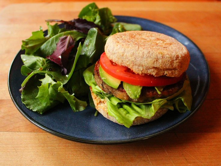 Mushroom and rice burger on a whole wheat English muffin with lettuce, tomato, avocado, and roasted garlic hummus. Baby spinach and lettuces with a balsamic vinaigrette.  #healthy #mealidea #burger #dinner