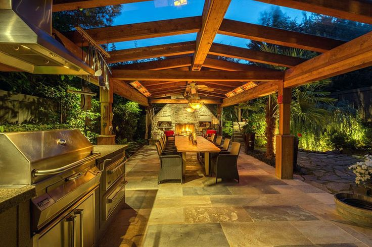Wood pavilion with outdoor kitchen and dining table