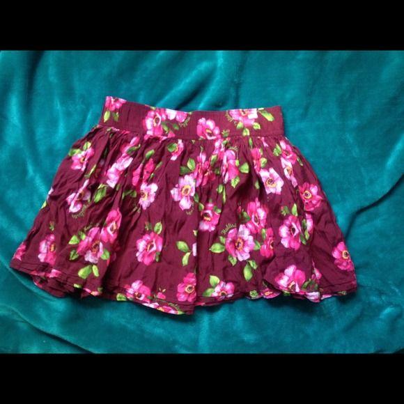 Floral Hollister Skirt Short burgundy floral skirt in excellent condition!! Hollister Skirts