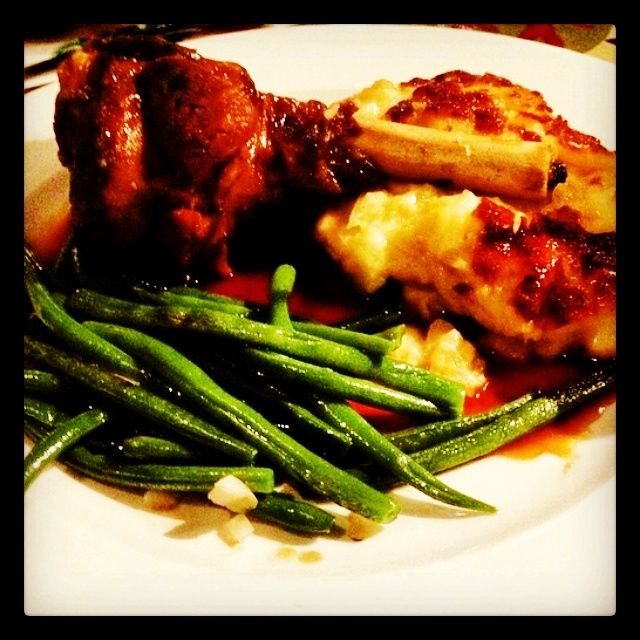 Lamb Shank: Lightly seasoned, slow cooked shank of lamb in a balsamic glaze, served with potato gratin and green beans!