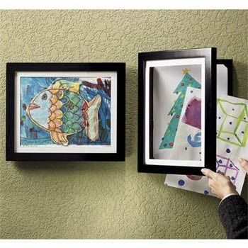 Use shadow boxes to display artwork. Let your child choose only his favorite pieces to frame and then swap them out each month.