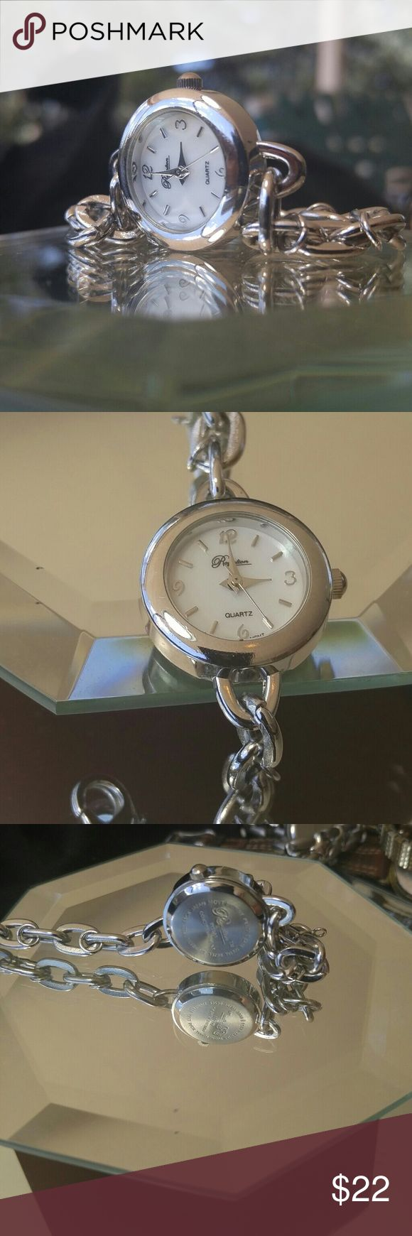 Ladies watch Ladies Silver and. White Raymond watch Chain band excellent shape like new.I've been through it, had it  adjusted. I put a new battery in it. Everything works perfectly ready to go. Accessories Watches